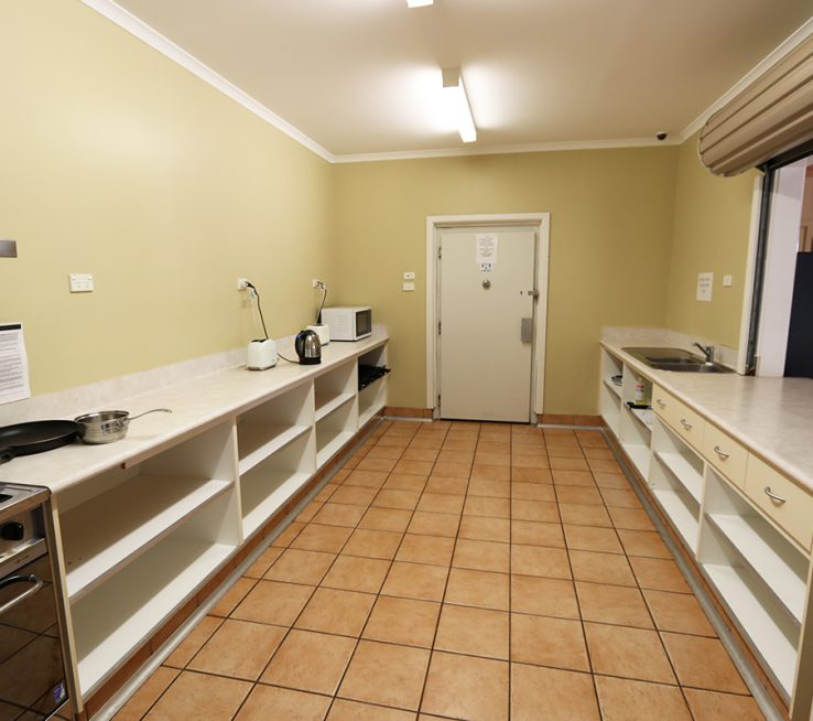 The large camp kitchen has a variety of cooking facilities including stove, oven and other appliances.